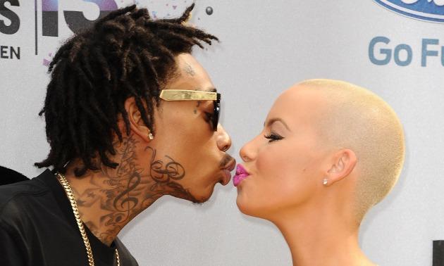 wiz-khalifa-and-amber-rose-kissing-getty