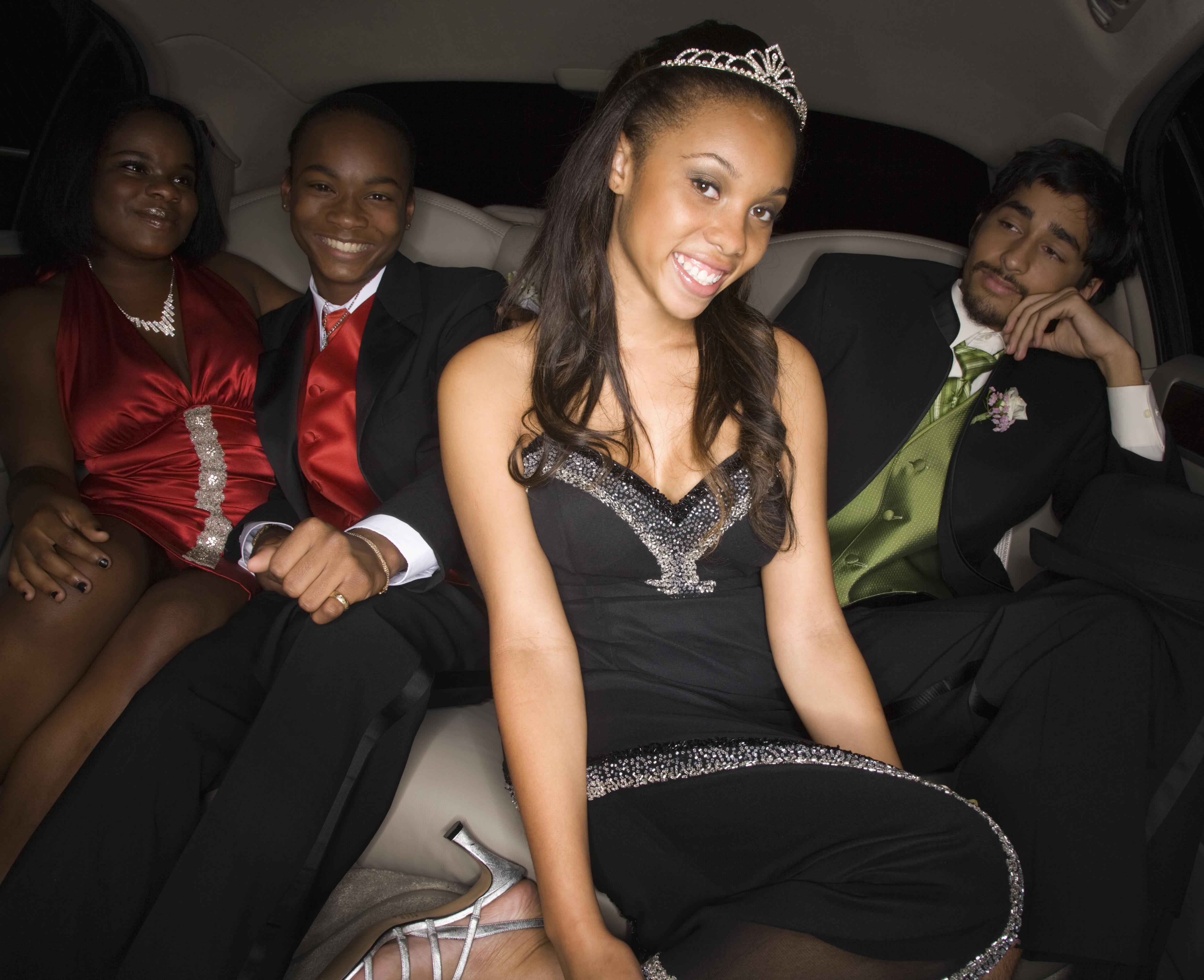 Multi-ethnic teenagers in limousine