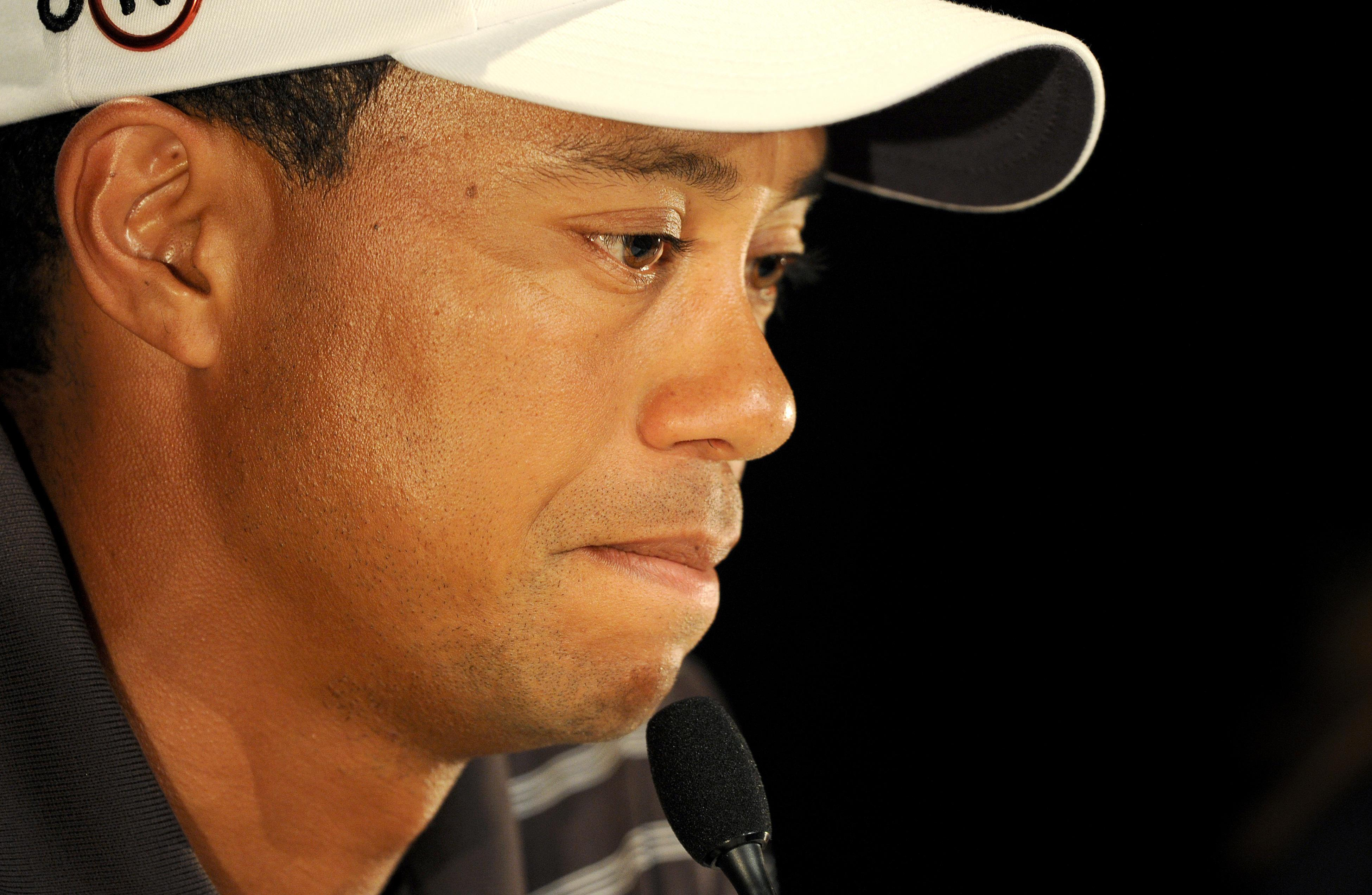 Tiger Woods speaks during a press confer