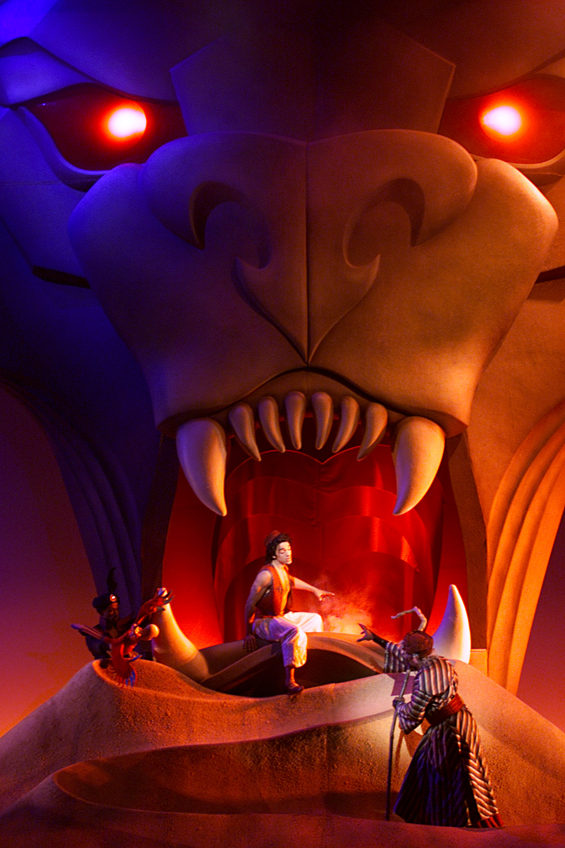 Center,left and right–In the scene 'Cave of Wonders' Aladdin, portrayed by Miles Wesley, is surround