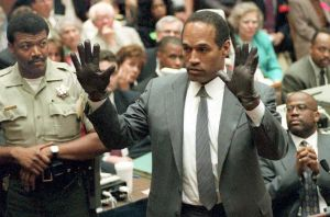 O.J. Simpson shows the jury a new pair of Aris ext